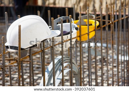 Workers helmets hooked to steel reinforcement. The focus forward - stock photo
