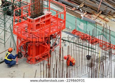 workers in construction zone - stock photo