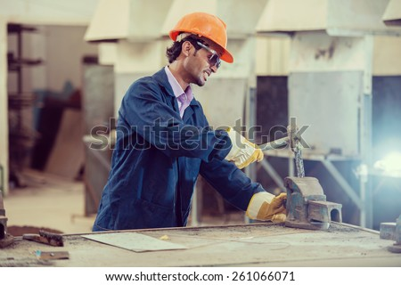 Workers in iron steel industrial factory - stock photo