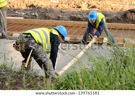 Workers in the road construction - stock photo