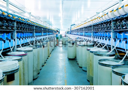 Workers in the spinning mill - stock photo