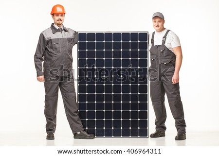 workers in uniform with solar panels workman white studio - stock photo