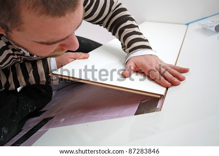 Workers laid laminate in home renovation - stock photo
