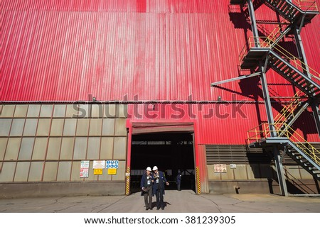 Workers molders and casters outside production shop of smelter hall, foundry factory AURUBIS, Pirdop, Bulgaria, Novemebr 05, 2015. - stock photo