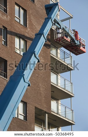 Workers on a aerial access platform - stock photo