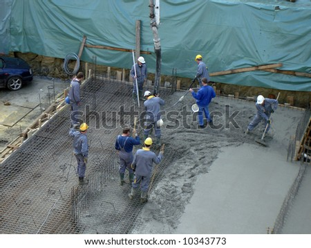 Workers on a construction site - stock photo