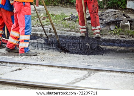Workers on a road construction - stock photo