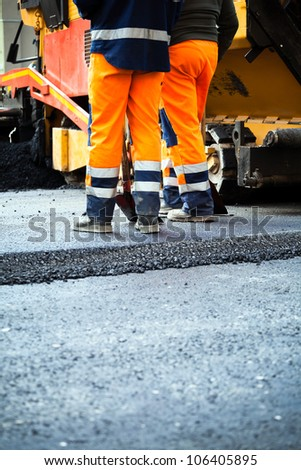 Workers on a road construction, industry and teamwork - stock photo