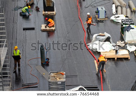Workers on basement of new building - stock photo