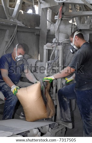 Workers on the cement factory - stock photo