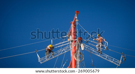Workers repairing a high voltage industrial power energy line. Great for energy, safety and technology themes.  : Almada, Portugal - October 02, 2008