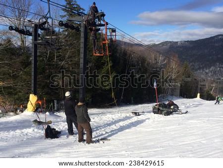Workers repairing the ski lift in mountain resort - stock photo