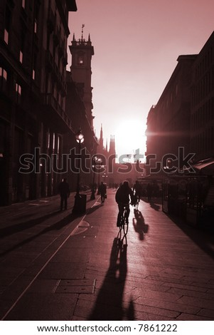 Workers riding on the bike in the morning to their job place in Milan