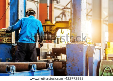 Workers to work alongside machinery leveler - stock photo