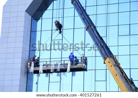 Workers wash the modern office building