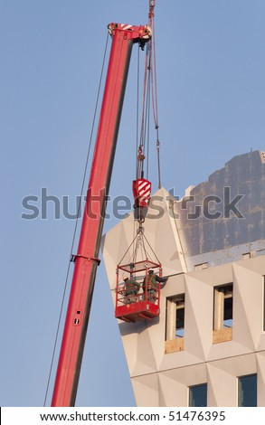 stock photo workers wearing safety harness in a hoist basket 51476395 fall arrest stock images, royalty free images & vectors shutterstock  at gsmx.co