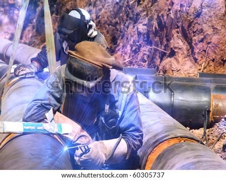 Workers  welders  repair   pipeline - stock photo