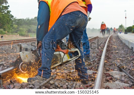 Workers were cutting tracks for maintenance. - stock photo