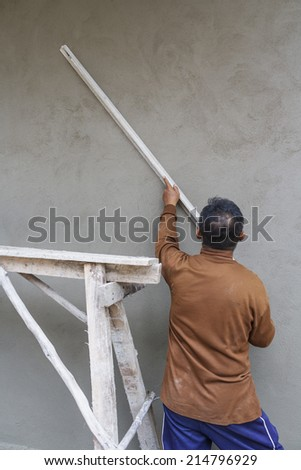Workers were plastering on wall in house. - stock photo