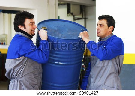 Workers with drum - stock photo