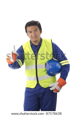 workers with personal protective equipment shows thumb up