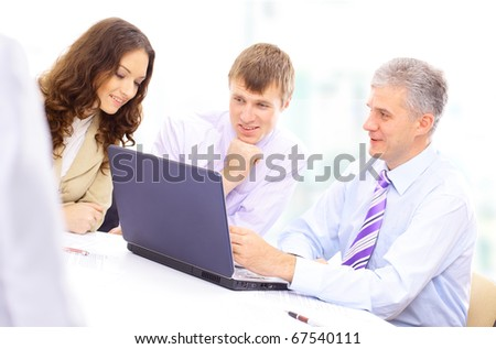 Workgroup interacting in a natural work environment - stock photo