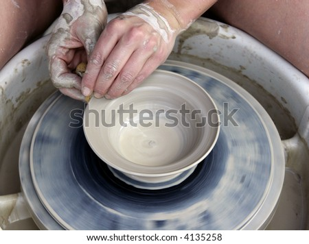 Working a clay pot - stock photo