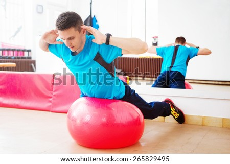 Working abs at gym with pilates. - stock photo