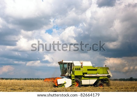 working agricultural machinery in sunny day, machinery series - stock photo
