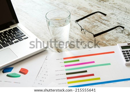 Working, analyzing graphics and doing calculations  - stock photo