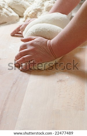 Working and mixing two dough on the counter - stock photo
