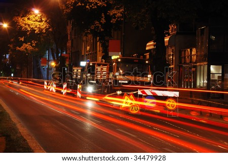 Working area in traffic at night - stock photo