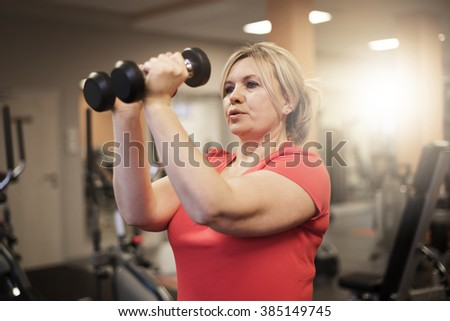 Working arms at the gym  - stock photo