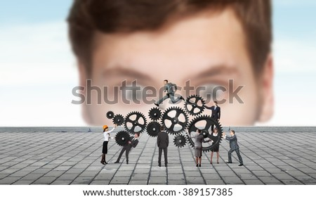 Working as one mechanism - stock photo