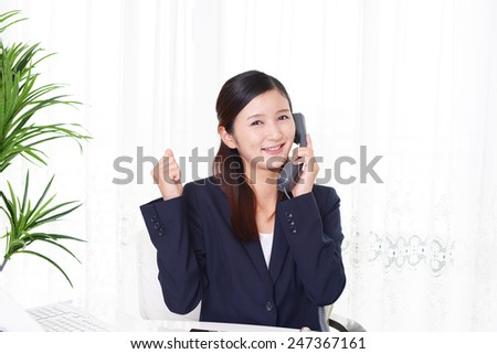 Working Asian business woman - stock photo