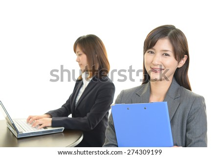 Working Asian business women at the office - stock photo