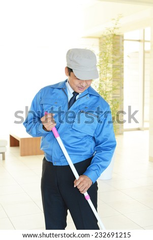 Working Asian janitor - stock photo
