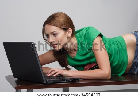 working at a home office lying on a table - stock photo