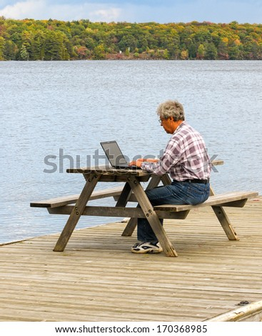 Working at a lake - stock photo