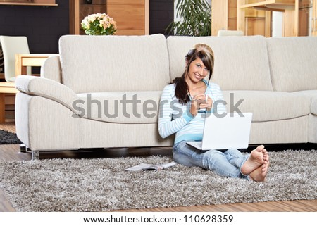 working at home on lounge - stock photo