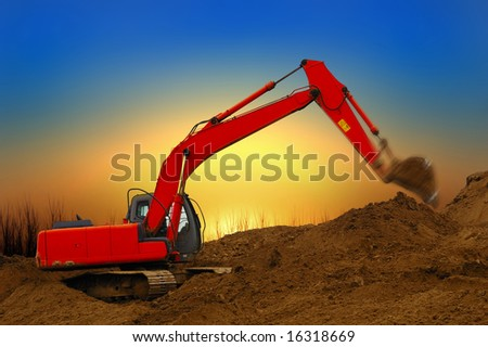 Working building dredge at sunset - stock photo