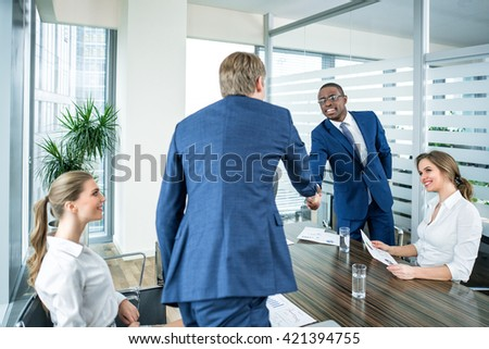 Working business people in office - stock photo
