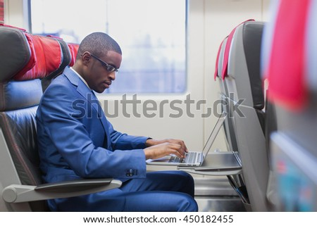Working businessman in a train - stock photo