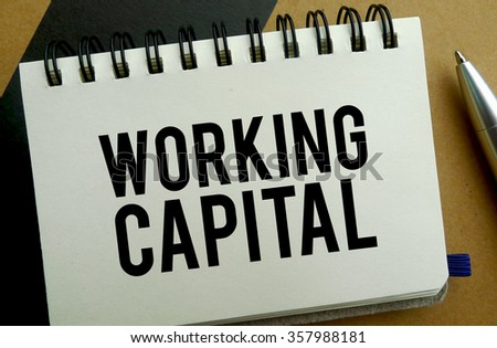 Working capital memo written on a notebook with pen