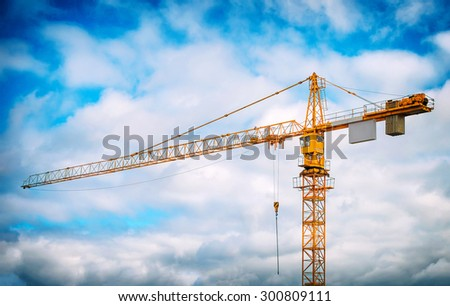 Working crane in the sky. Construction site. - stock photo