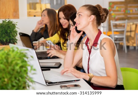 Working days. Women's team. Four young women - office staff. Joint work on the project. Woman business. Women working in the office at the computer. Group of women. Group of students. Toned image.  - stock photo