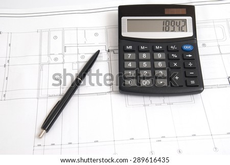 Working drawing with calculator and pen. Engineering background - stock photo