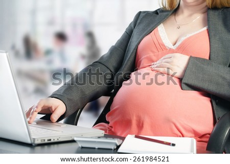 Working during pregnancy - stock photo