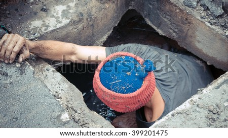 Working for drain cleaning. Problem with the drainage system. , process in vintage style - stock photo
