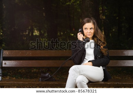 Working from everywhere  - phoning in woods - stock photo